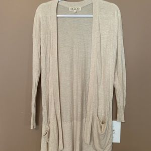 A long cream cardigan with pockets!